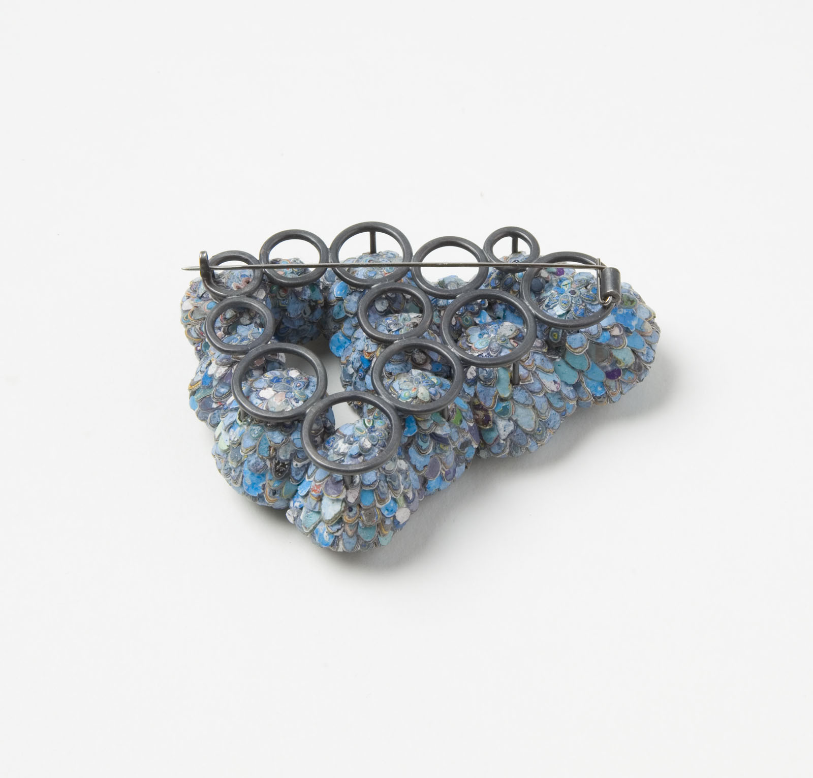 """The Secret Keepers (Blue 1)"" I Brooch, 2016 I Seed pods, graffiti, glass, silver, stainless steel I Photo: Mirei Takeuchi"