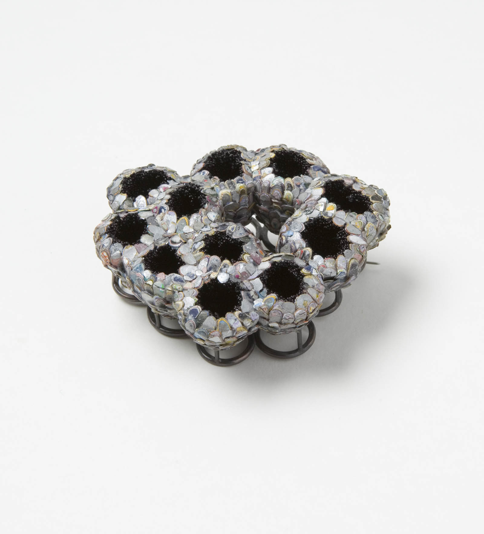 """""""The Secret Keepers (Silver)"""" I Brooch, 2016 I Seed pods, graffiti, glass, silver, stainless steel I Photo: Mirei Takeuchi"""