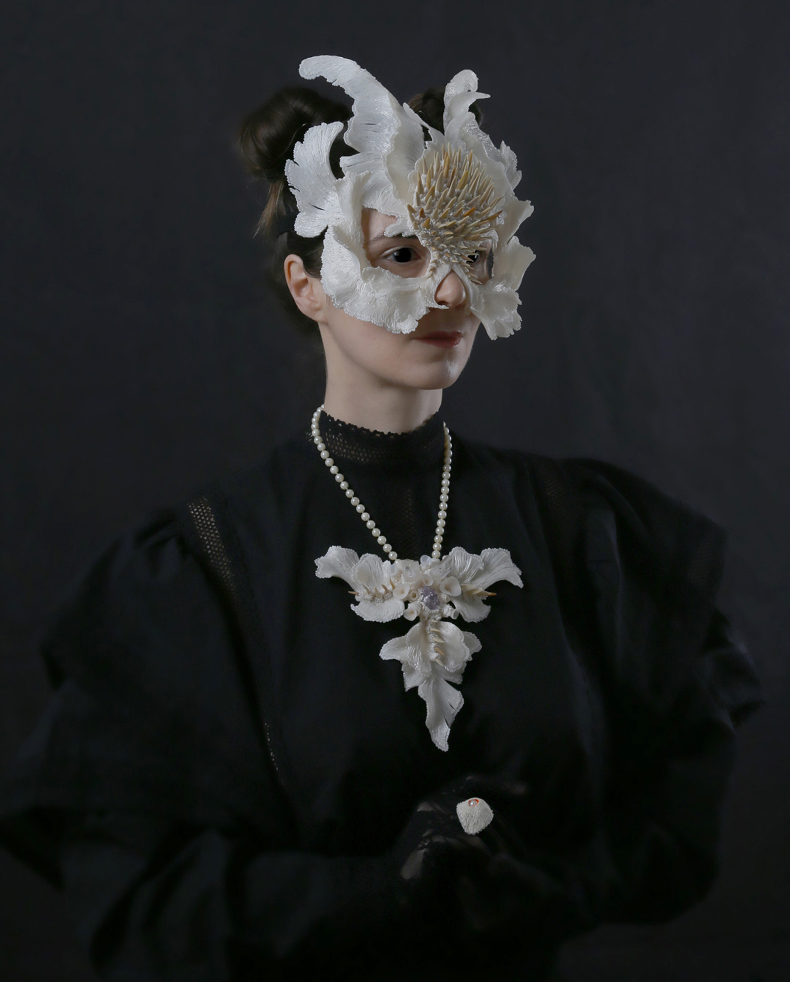 """The Lonely Beast"" I Mask, 2019 I PLA, fossil shark teeth & ""Icarus I"" I Necklace, 2019 I PLA, fossil shark teeth, crystals, second hand pearls, silver I Photo: Attai Chen"